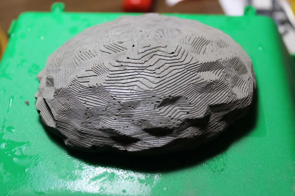 A fresh cast rock, showing the layer lines of the mold. While a nice visual effect, you may want to sand these line out to conceal the rocks nature.